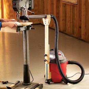 Adjustable vacuum hose holder.