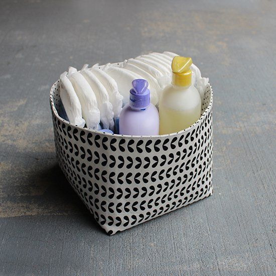 Clutter around the house!? Make a reversible fabric storage bin in just a few hours.
