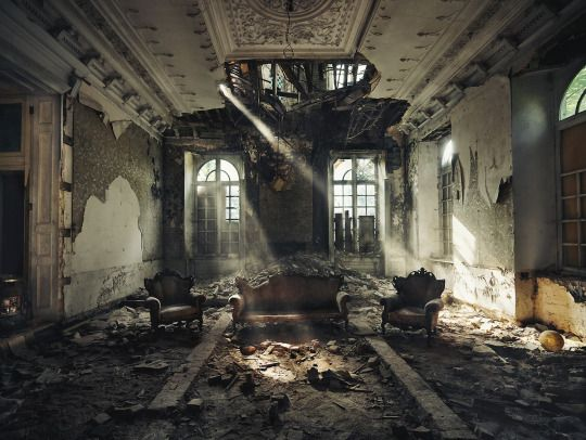 They all sat in the decaying house, overgrowth poking through their clothes.