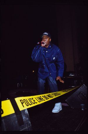 Dr Dre in his NWA years, captured on stage in London behind crime-scene tape. According to photographer Normski, who was shooting the gig for Hip-Hop Connection, Dre came out angry about the negative portrayal of the band in the British tabloid press at the time