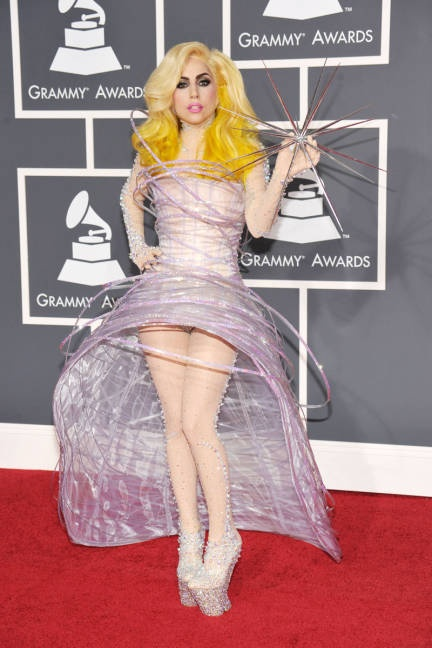 JANUARY 31, 2010 In one of her more iconic looks, Gaga walks the Grammy Awards red carpet in a Glinda the Good Witch-inspired Armani Privé piece.