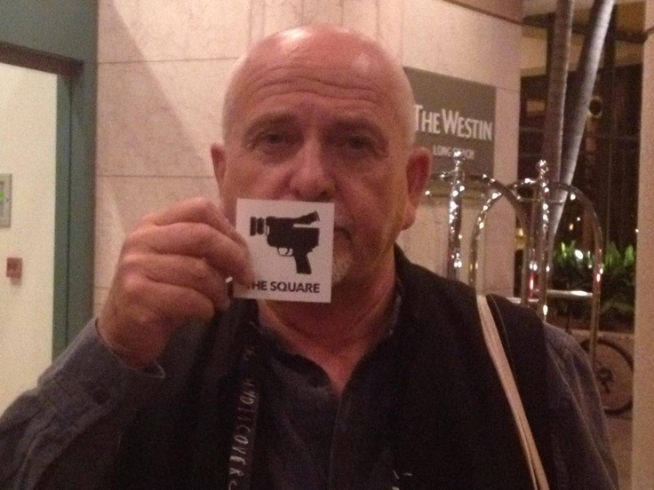 "Peter Gabriel shows his support for The Square at TED 2013 by holding up our stencil ""The Camera, Our Weapon"" Thank you Peter!"
