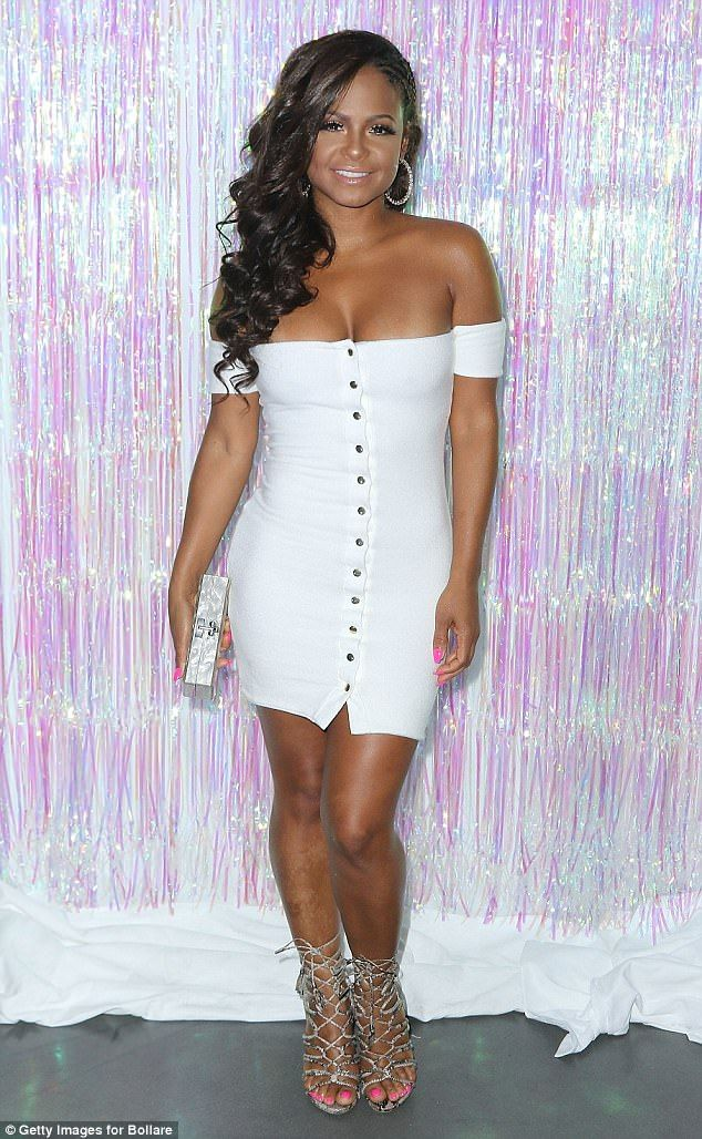 Pretty! Christian Milian stunned on the red carpet Thursday night in a tight white off-the-shoulder dress that showed off her enviable cleavage
