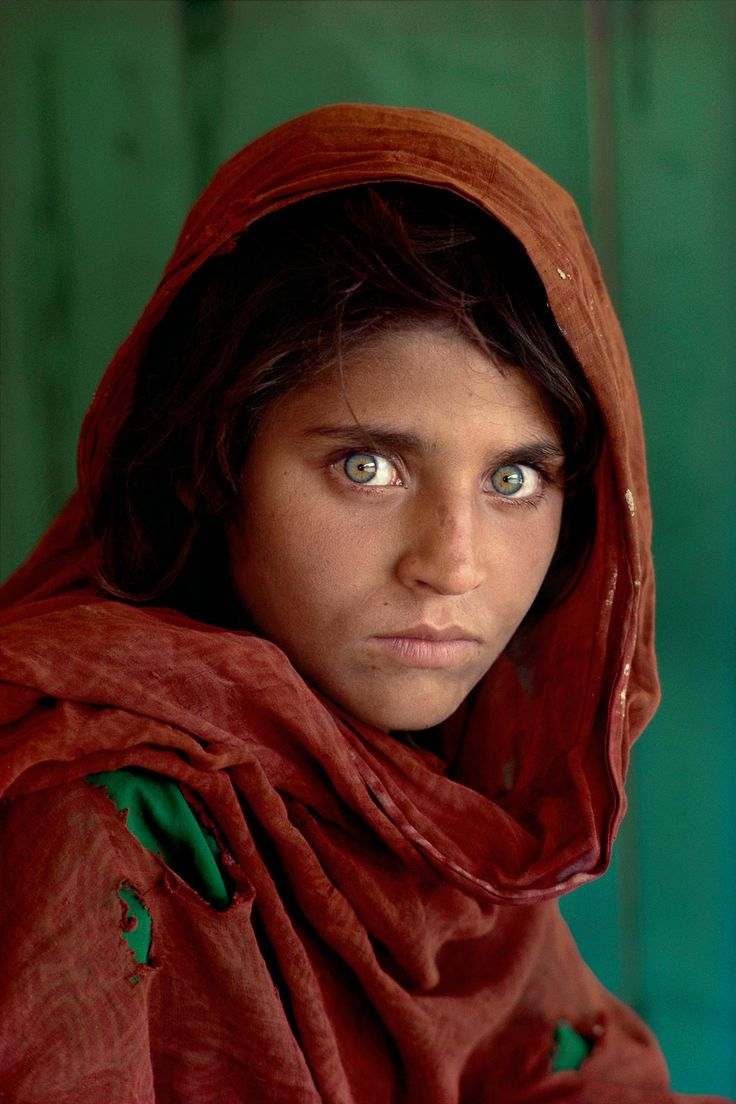 "Afghan girl, Pakistan, from ""Portraits"" by Steve McCurry -- possibly the single most famous cover photo for National Geographic ever made. He did not know her name and did not find her again for nearly 20 years."