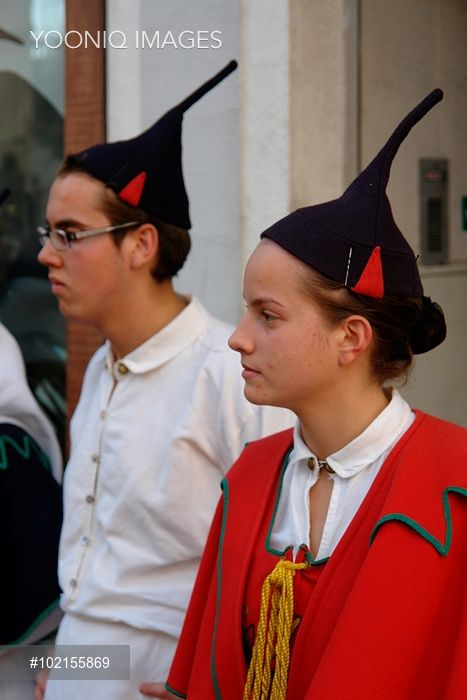 Two young members of a Boa Nova folklore group, seen here in Funchal, the capital city of Madeira. They are wearing traditional costume, including black skull caps with points.
