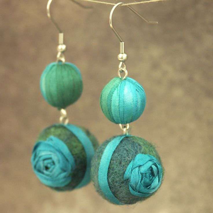 Earrings made of silk and wool.