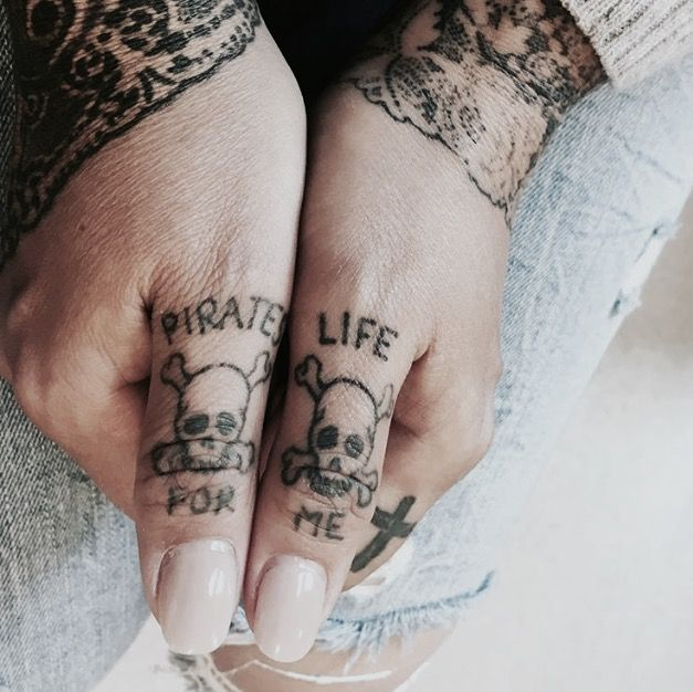 """Pirates life for me"" tattoo with skulls"