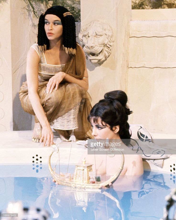British-born actress Elizabeth Taylor (1932 - 2011, right) in a bath scene from 'Cleopatra', directed by Joseph L. Mankiewicz, 1963.