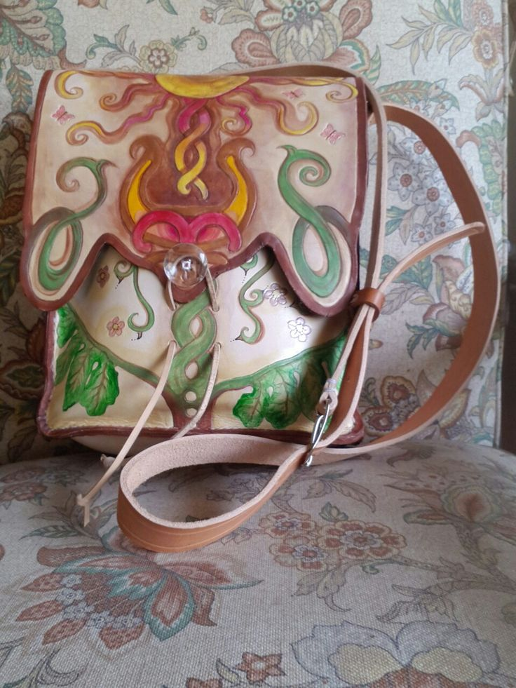 Celtic sun & moon bag front view with flap closed, 3 compartments
