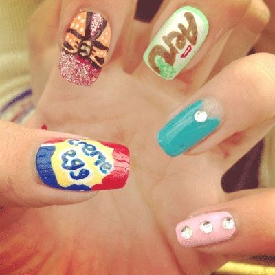 Nail Art We're Loving: We love blogger Ashleigh's quirky mix 'n' match design featuring rhinestones and chocolate bars!
