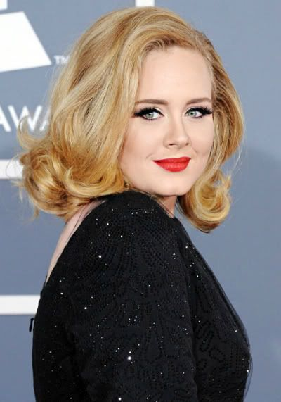 YEAR of adele. album 21 makes her women of the year, tied with beyonce for most grammy's