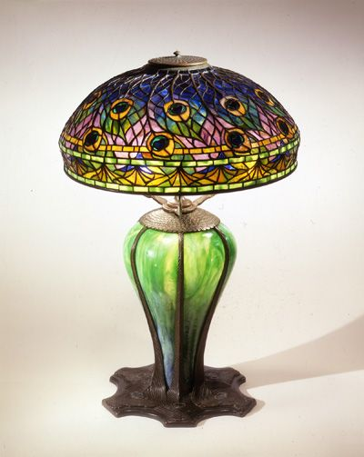 Louis Comfort Tiffany  American, 1848–1933  Peacock Library Lamp   leaded glass, bronze with blown glass, glass mosaic inlay, 1900 – 1910  27 1/2 x 18 inches