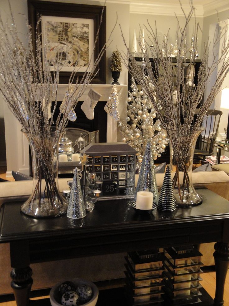 Christmas Decorations by Chris Comwyn Culbreth Smith: My family room decorated in silver, mercury glass, and mirrored holiday accents. I love decorating for the holidays. It was something I always enjoyed doing with my mother when I was a child. My mom had many decorating traditions, with several that I continue today.  As a web and graphic designer, decorating for Christmas allows me to be creative off line instead of online for a change! http://comwyn.com/getting-creative-for-christmas/