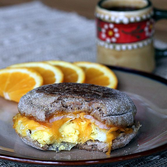 Make-Ahead, Healthy Egg McMuffin   12 large eggs (may substitute Egg Beaters or use all egg whites, if desired)  12 100% whole grain English muffins  12 slices Canadian bacon or cooked turkey sausage patties  12 slices low calorie cheese (ultra-thin regular cheese or low-fat cheese; look for 45 calories or less per slice)  black pepper, freshly ground