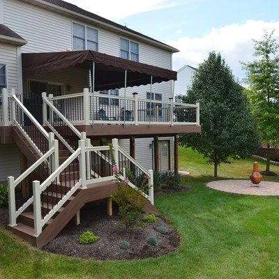 TimberTech Earthwood Decking In Pacific Walnut, Almond Vinyl Railing.  Notice The Stair Design With Two Exit/entrances And Landing.