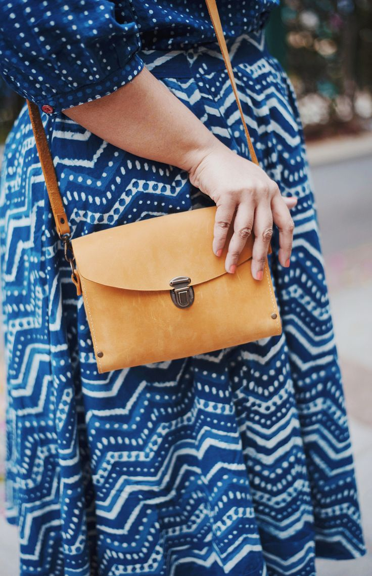 Mix patterns with the color and add a neutral clutch to balance out the busy!