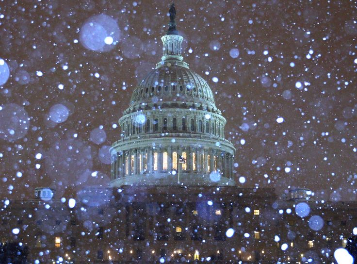Snow fell in front of the US Capitol building in Washington DC.
