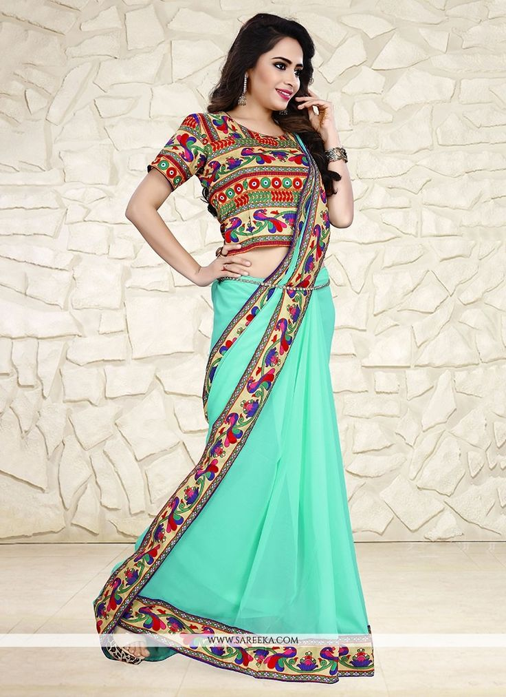 Grab the second look in this elegant attire for this season. Add grace and charm to your appearance in this beautiful turquoise georgette printed saree. Look ravishing clad with this attire which is e...