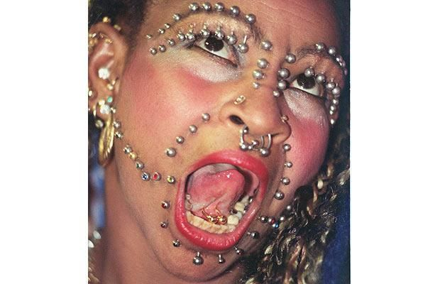 . Elaine Davidson, a Brazilian Nurse, had a whopping 462 piercings all over her body. However, in March of 2012 she upped the ante and set a new world record of over 9000 piercings. To date her piercings weigh approximately 3 kg and most of them are centred in her genital region.
