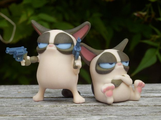 Don't Get Grumpy... Get Even! 3d printed Please note- you only get the cat on the left with guns with this order. The seated cat can be bought seperately