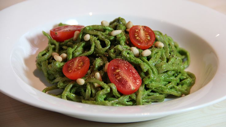 Above: Raw pesto sauce mixed with whole wheat spaghetti topped with pine nuts and cherry tomatoes. Pesto, for lovers of Italian authentic cuisine, is simply basil sauce made by the infusion of basic leaves, oil, pine nuts, garlic, and Parmesan. To add, it may also be a flavourful paste made by pureed spices and herbs, …