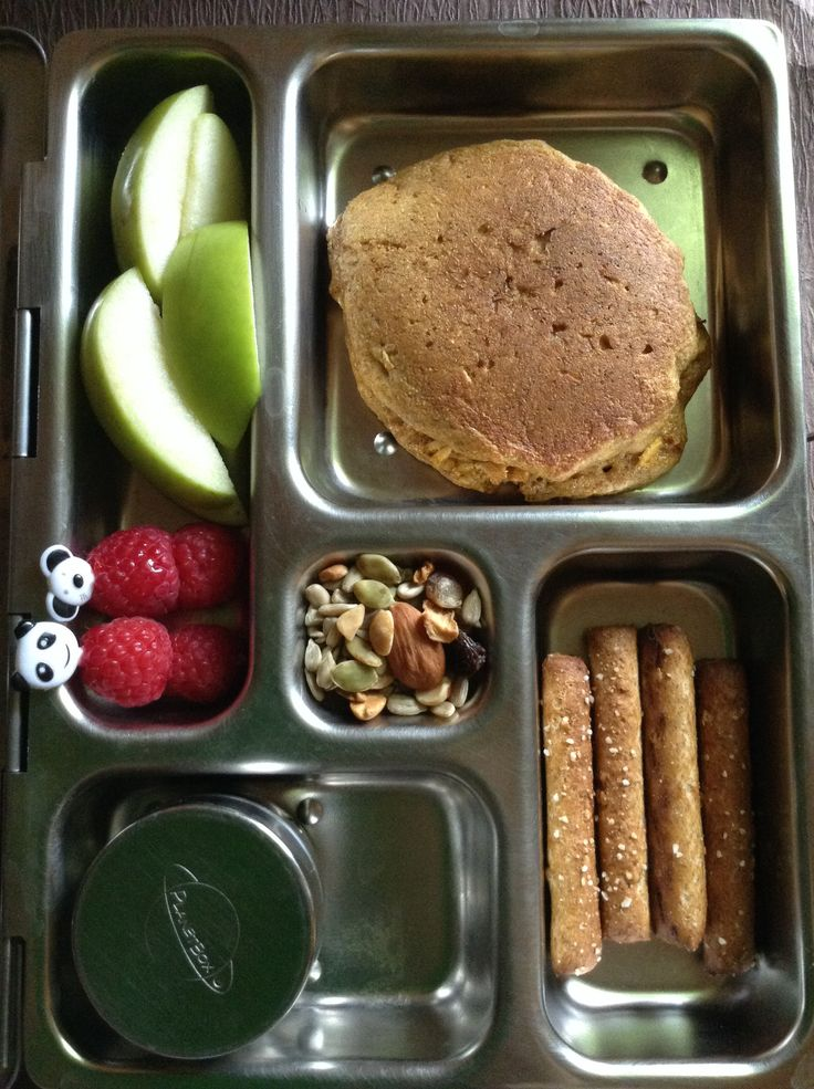 Planetbox lunch with whole wheat vanilla almond pancake, whole grain pretzels, raspberries, apples, and trail mix