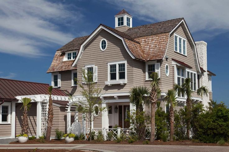 This shingle style beach house was designed by T.S. Adams Studio, Architect, along with Urban Grace Interiors, ideally located in Watersound, Florida.