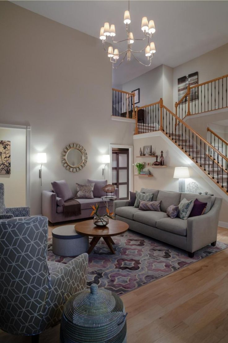 Contemporary living room design ideas zillow digs - Muted Purples And Grays Allow For A Mix Of Bold Patterns In This Contemporary Living Room A Funky Chandelier And Stylish Starburst Mirror Add Pizz