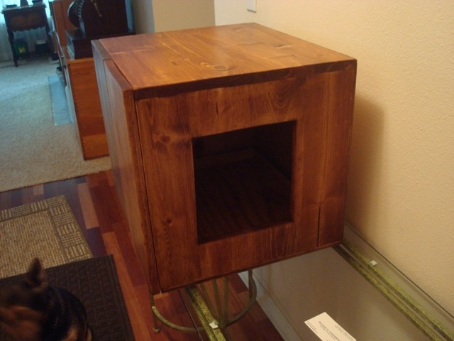DIY litter box cabinet to hide the litter box and keep the dogs out