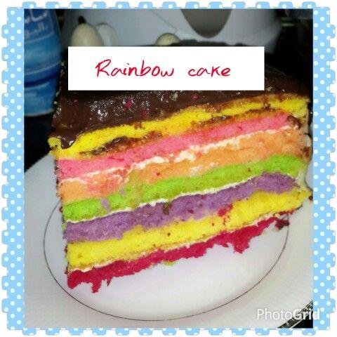 Rainbow cake   By  nura darmawan    erigu 375 gram 5 butir telur .ambil yg putih nya aja 4 sdt baking powder 1 / 2 sdt garam Mentega tanpa (pilih yang tanpa garam) 250 gram Gula pasir 450 gram Vanila bubuk 2 sendok teh Susu cair 350 ml Mentega (sedikit untuk mengoles loyang untuk memanggang) Pewarna makanan sesuai warna selera  Cara Membuat Rainbow Cake Siapkan oven dan nyalakan pada suhu kira-kira 175 derajat celcius. Siapkan loyang (ukuran sesuai selera, rekomendasi diameter 23 cm), olesi…