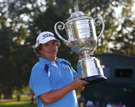 Jason Dufner wins the 2013 PGA Championship 10-under-par for his first major title - @Sharon Pula  Photo: Jason Dufner of the U.S. poses with the Wanamaker trophy after winning the 2013 PGA Championship golf tournament at Oak Hill Country Club in Rochester, New York August 11, 2013. (Reuters/Jeff Haynes)