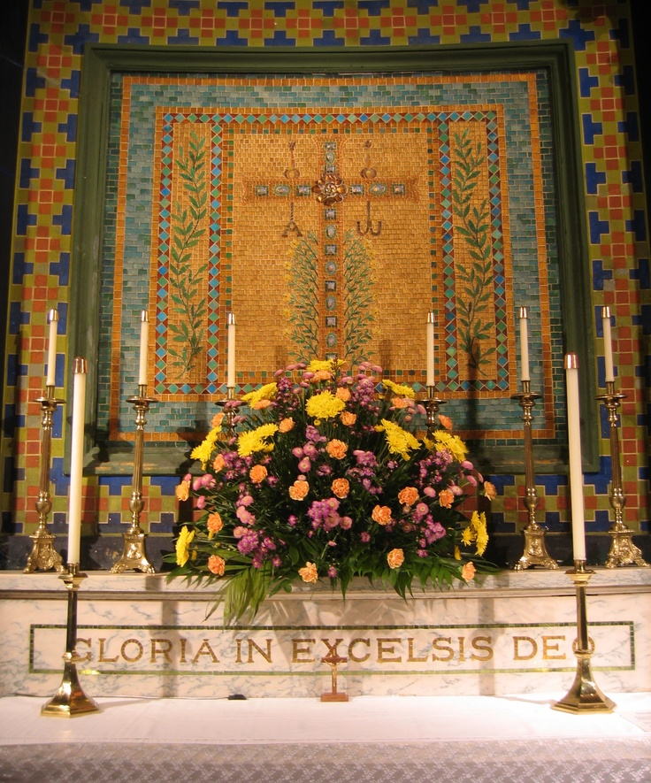 The mosaic above the altar was designed by Tiffany and Co.