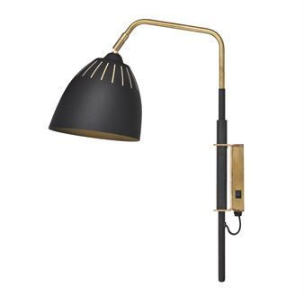 Lean wall lamp from Örsjö Belysning is designed by Jenny Bäck. It has a retro inspired design that reminiscent of classic 50's lamps and has got its name after its relaxed and leaning look. It's made in lacquered metal and has classy details and switch in raw brass. The shade is adjustable and the whole lamp can be turned from left to right. Perfect for the reading corner or to use as a bedside lamp!