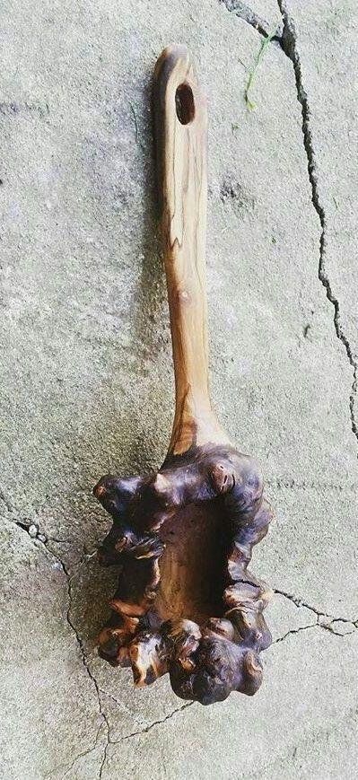 Handmade rustic spoon from wood burl.