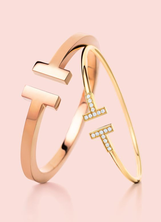 Tiffany T for two. From left: Tiffany T square bracelet in 18k rose gold and Tiffany T wire bracelet in 18k yellow gold with diamonds.: