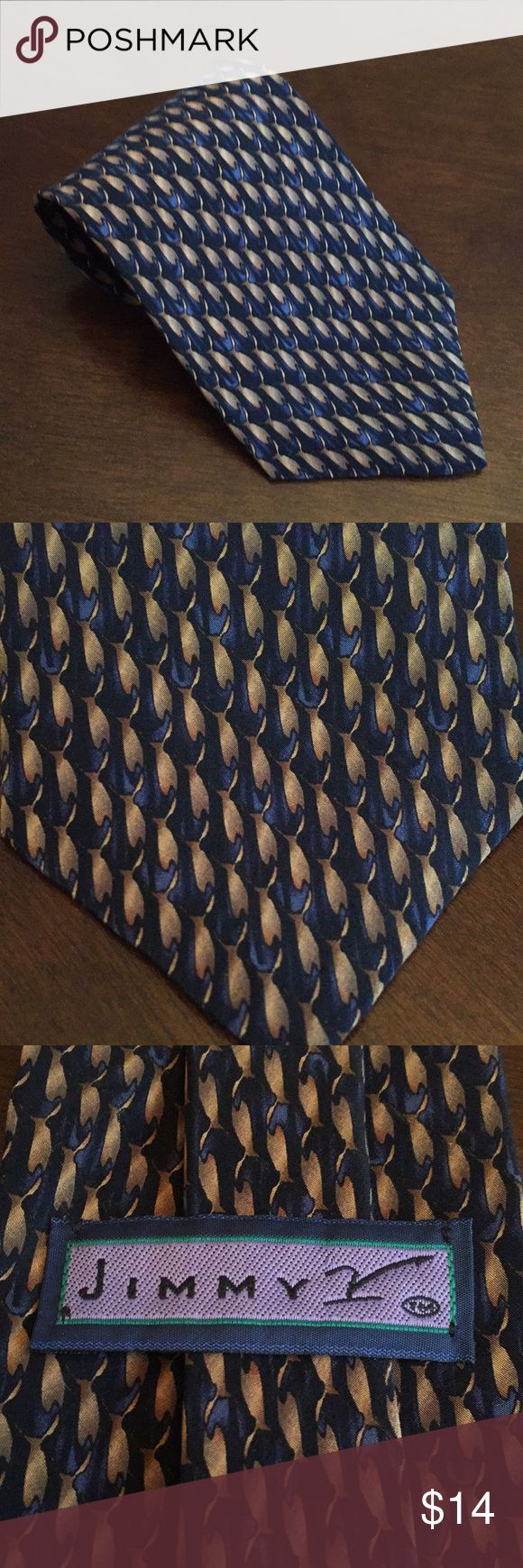 Jimmy V necktie Check out this black and blue necktie from the Jimmy V Collection.  Original Purchase price helped raise funds for cancer research thru The V Foundation. Very good condition.  Black, dark blue and gold pattern. Accessories Ties