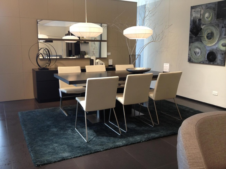 Great solution... Give your Dining room some extra space. Use 2 horizontal mirrors placed in a simetrical way on top of your side board. BoConcept AV.19 Bogota