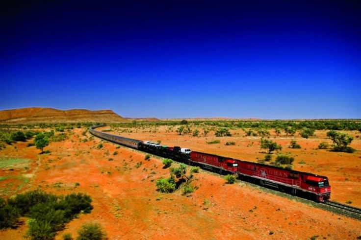 The Ghan rolling through the great Australian Outback
