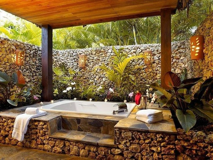 Perfect outdoor bathtub & relaxation space!  The lights