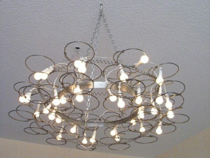 Repurpose vintage old bedsprings into a chandelier light fixture. Salvage, upcycle, recycle bed springs. For ideas and goods shop at Estate ReSale & ReDesign, in Bonita Springs, FL
