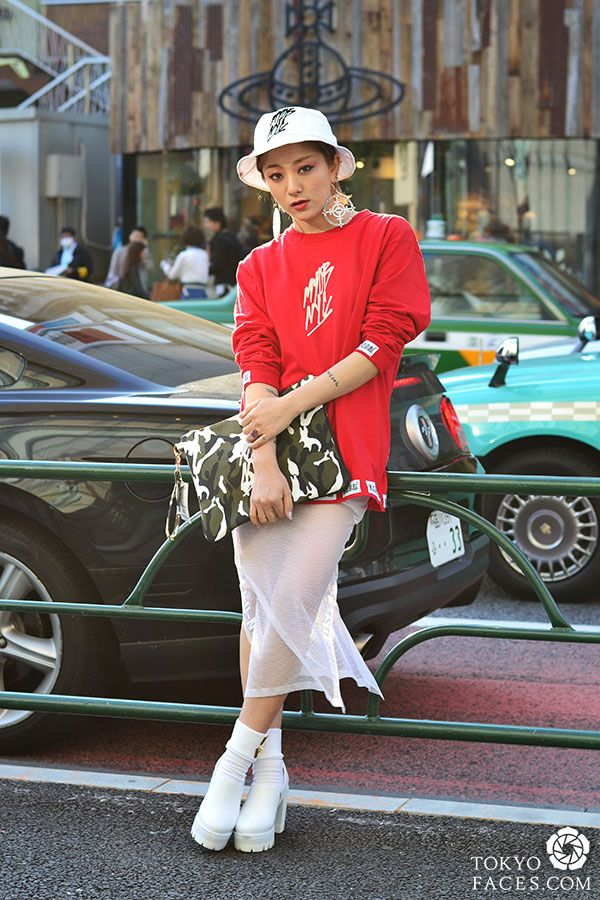 On the streets of Tokyo, the hat and loose oversized sweatshirt balances perfectly with the sheer white skirt and chunky heels.
