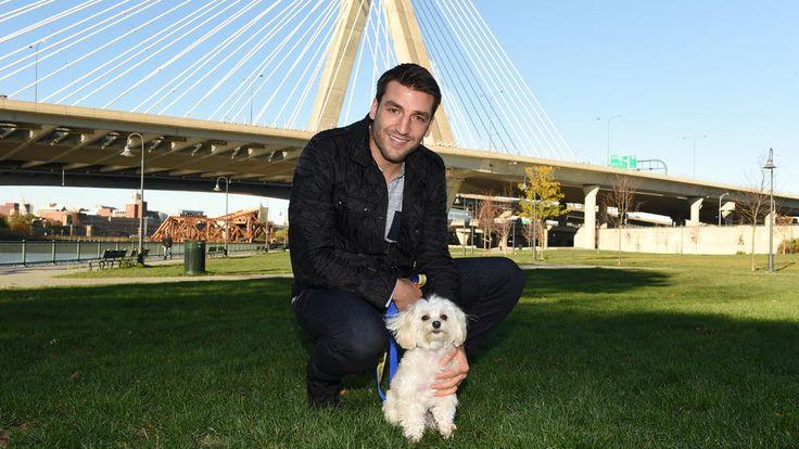 Patrice Bergeron and his dog, Wilson(Source: Boston Herald)