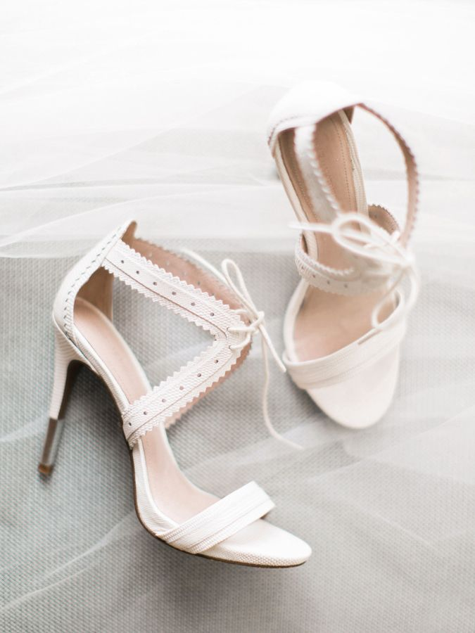 Chic white leather bridal shoes: http://www.stylemepretty.com/2015/12/29/al-fresco-catalina-view-gardens-wedding/ | Photography: Troy Grover - http://blog.troygrover.com/
