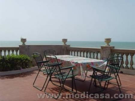 Sicily!  Beside Inspector Montalbano's house!  I just need 9 other people to share in order to afford it.