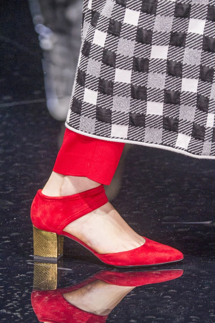 Red shoes pops any outfit.  www.workinglook.com