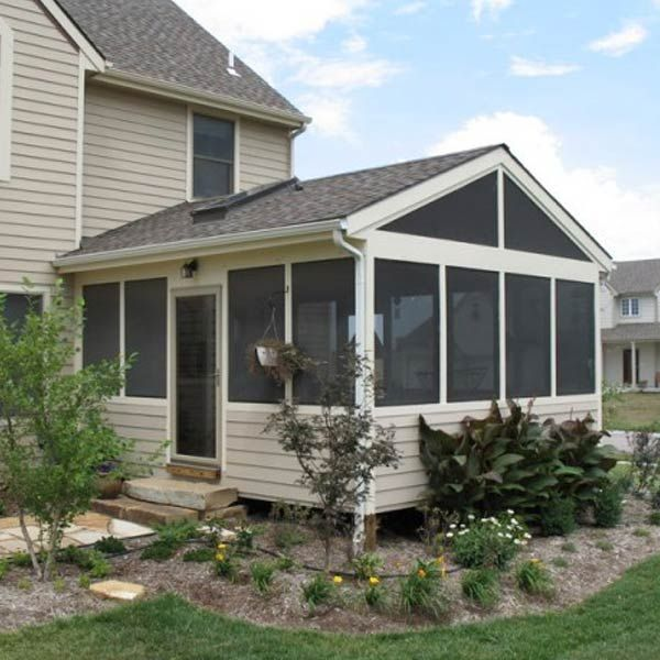 Custom designed to blend with and extend this patio home is a right-sized screened porch that leads from the eat-in kitchen.