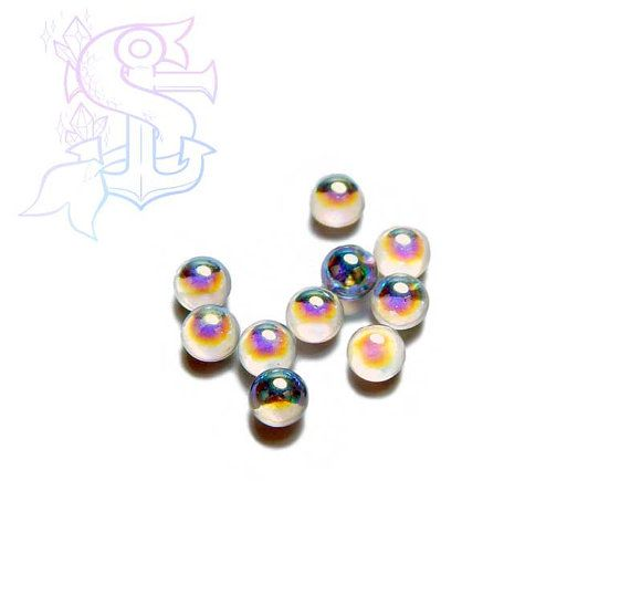 You will receive 10 cabochon spheres. Color is a white iridescent that shifts in pastel color hues. They can be used for different purposes as fine handmade jewelry, and many others craft project! Please allow a minimum color differences due to different monitor settings from mine to yours! (¯`·.¸¸.-> °º Cabochon measurements: ø4mm º° <-.¸¸.·´¯)  .•°¤*(¯`★´¯)*¤°°¤*(¯´★`¯)*¤°•..•°¤*(¯`★´¯)*¤°°¤*(¯´★`¯)*¤°•..•°¤*(¯`★´¯)*¤°  *Shipping method informations*   You can choose between 2 shipping…