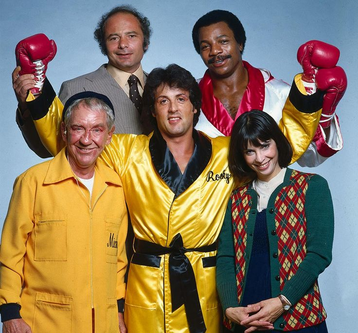 Sylvester Stallone (Rocky Balboa) poses with the cast of Rocky II — Burgess Meredith (Mickey Goldmill), Burt Young (Paulie), Carl Weathers (Apollo Creed), and Talia Shire (Adrian) — Nov. 1978 in Los Angeles. (Neil Leifer for SI)