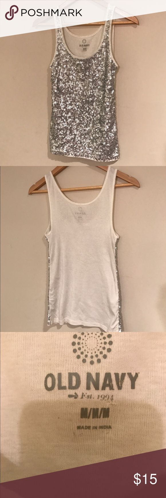 Sequin Tank top Fun, white sequin tank top.  Super comfy and cute! Worn twice with some fading of the tag information seen in picture.   No trades, firm price.  **Bundle and Save💵!** Old Navy Tops Tank Tops
