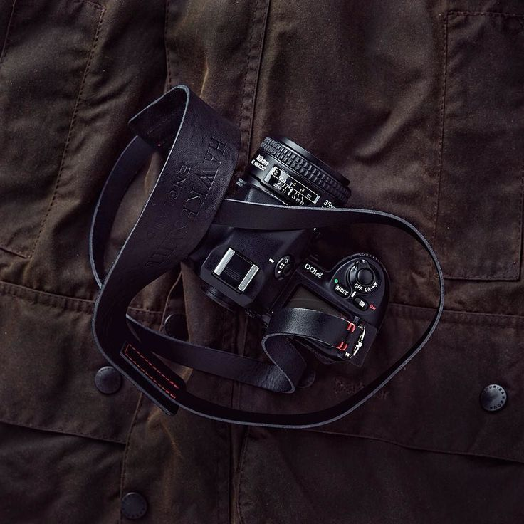 One of the best cameras ever. The legendary Nikon F100 resting very comfortably on this Barbour Beaufort jacket, our camera strap attached.